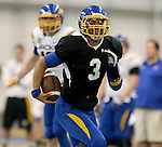 BROOKINGS, SD - APRIL 23:  Taryn Christion #3 from South Dakota State breaks loose for a big gain during their Spring Game Saturday afternoon at the Sanford Jackrabbit Athletic Complex in Brookings.  (Photo by Dave Eggen/Inertia)
