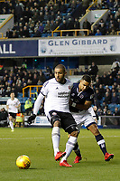Leon Clarke of Sheffield United holds off James Meredith of Millwall during the Sky Bet Championship match between Millwall and Sheff United at The Den, London, England on 2 December 2017. Photo by Carlton Myrie / PRiME Media Images.
