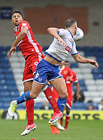 Milton Keynes Dons' Osman Sow and Bury's Tom Aldred in action<br /> <br /> Photographer Juel Miah/CameraSport<br /> <br /> The EFL Sky Bet League One - Bury v Milton Keynes Dons - Saturday 30th September 2017 - Gigg Lane - Bury<br /> <br /> World Copyright &copy; 2017 CameraSport. All rights reserved. 43 Linden Ave. Countesthorpe. Leicester. England. LE8 5PG - Tel: +44 (0) 116 277 4147 - admin@camerasport.com - www.camerasport.com
