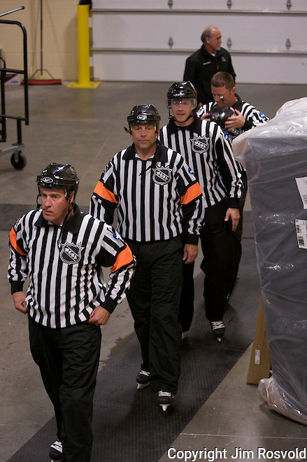 The referees prepare to take the ice.