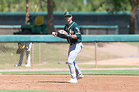 Oakland Athletics third baseman Max Schuemann (45) prepares to throw to first base during an Instructional League game against the Los Angeles Dodgers at Camelback Ranch on September 27, 2018 in Glendale, Arizona. (Zachary Lucy/Four Seam Images)