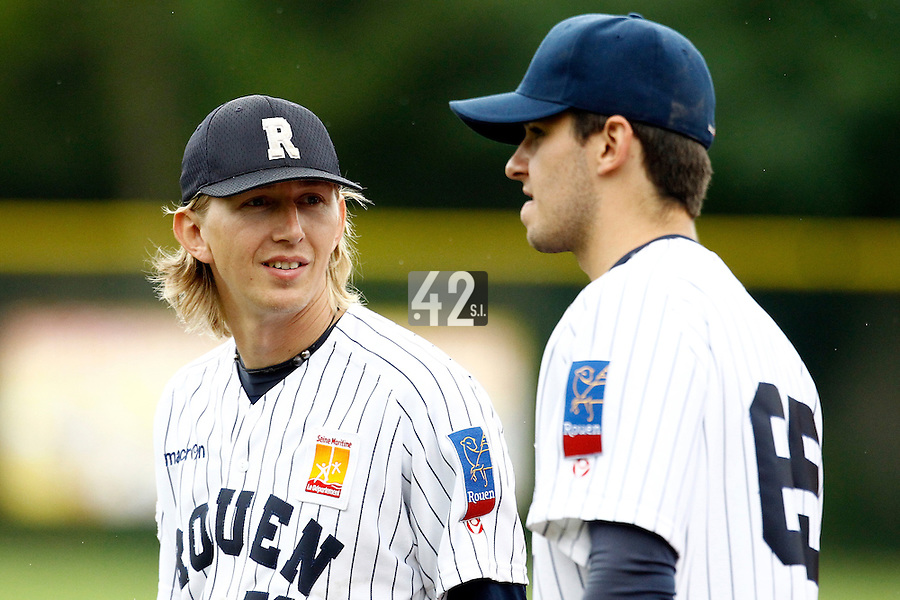 17 July 2011: Luc Piquet of the Rouen Huskies talks to Quentin Becquey during the 2011Challenge de France final match won 6-4 by the Rouen Huskies over the Savigny Lions, at Stade Pierre Rolland, in Rouen, France.