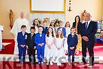 Pupils from St Finian NS Waterville who made their 1st Holy Communion on Saturday in Saint Finian's Church were front l-r; Fionain Brain, Juan Felipe Kearney, A.J. O'Sullivan, Alanna Murphy, Laurren O'Sullivan, Alex Driscoll, back l-r; Gerard Finucane, Orlaith Walsh, Jack Coffey, Mia Boyou, Jack Cross, Molly O'Dwyer, Niamh McCarthy & Gearóid Moran(Principal).