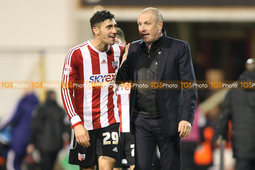 Brentford manager Mark Warburton celebrates with goalscorer Marcello Trotta of Brentford at the final whistle - Brentford vs Port Vale - Sky Bet League One Football at Griffin Park, London - 11/01/14 - MANDATORY CREDIT: George Phillipou/TGSPHOTO - Self billing applies where appropriate - 0845 094 6026 - contact@tgsphoto.co.uk - NO UNPAID USE