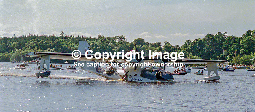 The Catalina Flying Boat, cruises to the jetty on Lough Erne near the Lough Erne Yacht Club, Killadeas, Co Fermanagh, N Ireland, on 25 May 1991 fifty years to the day after another Catalina flying from nearby Castle Archdale took off to and during the very long flight on 26 May sighted the German battleship, Bismarck, enabling Allied Forces to track and sink it on 27 May. 199105250029..Copyright Image from Victor Patterson, 54 Dorchester Park, Belfast, UK, BT9 6RJ..Tel: +44 28 9066 1296.Mob: +44 7802 353836.Voicemail +44 20 8816 7153.Skype: victorpattersonbelfast.Email: victorpatterson@mac.com.Email: victorpatterson@ireland.com (back-up)..IMPORTANT: If you wish to use this image or any other of my images please go to www.victorpatterson.com and click on the Terms & Conditions. Then contact me by email or phone with the reference number(s) of the image(s) concerned.