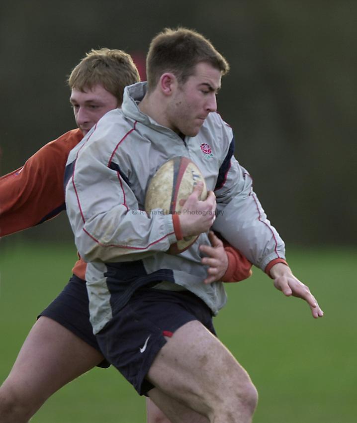 England Under 21's training.  Warwick University..Photo. Richard Lane..14-2-2002.Ian Clarke gets tackeled by Martin Purdy
