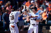 Oregon State Beavers Joe Casey (5) is congratulated by Ryan Ober (18) after scoring a run during an NCAA game against the New Mexico Lobos at Surprise Stadium on February 14, 2020 in Surprise, Arizona. (Zachary Lucy / Four Seam Images)