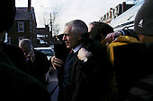 Manchester, New Hampshire.USA.January 26, 2004..Democratic presidential hopeful General Wesley Clark prepares for a rally at City Halll Plaza as he campaigns during the day of the primary..