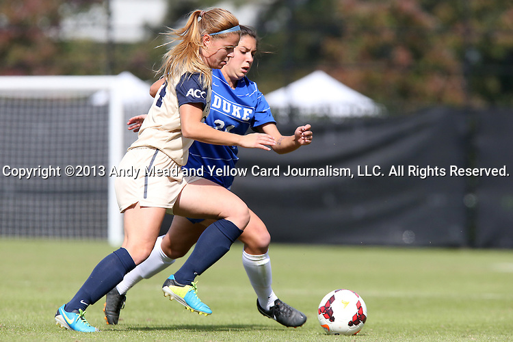 27 October 2013: Pittsburgh's Ella Vanhanen (FIN) (left) and Duke's Mollie Pathman (behind). The Duke University Blue Devils hosted the Pittsburgh University Panthers at Koskinen Stadium in Durham, NC in a 2013 NCAA Division I Women's Soccer match. Duke won the game 6-3.