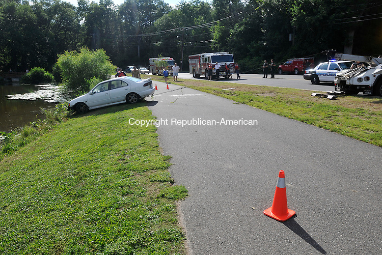 NAUGATUCK, CT-22 JULY 2010-072210IP09-  A car is pulled out of Baummer Pond in Naugatuck after it rolled without passengers from a driveway across the street and into the water. No one was injured.<br /> Irena Pastorello Republican-American