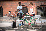 DENMARK, Copenhagen, Woman and man getting ready for a bike ride, Europe