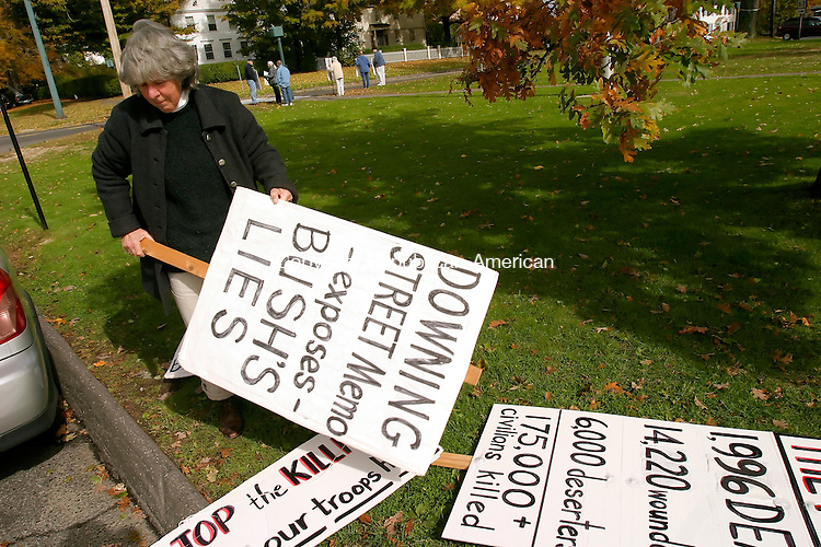 LITCHFIELD, CT - 23 OCTOBER 2005 -102305JS05- Anti-war protester Dorothea DiCello of Litchfield picks out a sign to hold on Sunday as part of a group that gathers on the Litchfield Green every Sunday to protest the war in Iraq. She decided against the Downing Street Memo sign, she said each week someone asks what it means.   --Jim Shannon Republican-American--Dorothea DiCello; Litchfield are CQ