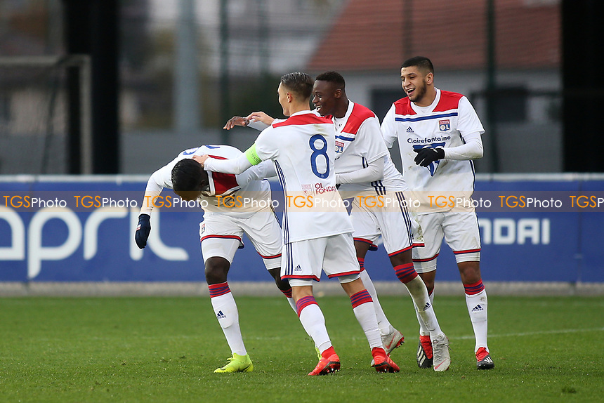 Olympique Lyonnais players congratulate Oumar Solet (far left) after scoring their second goal during Lyon Under-19 vs Manchester City Under-19, UEFA Youth League Football at Groupama OL Academy on 27th November 2018