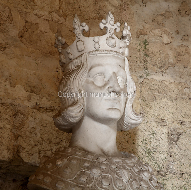 Plaster bust of Saint Louis or King Louis IX of France, 1214-70,  commissioned by Joseph Guyot in 1911, after the original in the Sainte Chapelle in Paris, in the communal hall in the donjon or keep of the Chateau de Dourdan, built 1220-22 by Guillaume de Flamenville under Philippe Auguste, replacing an earlier wooden structure, Dourdan, Hurepoix, Essonne, France. In 1652, Louis gave the castle to his mother, Anne of Austria. The castle is built on a square plan, with towers along the sides, at 3 of the corners and an isolated donjon at the 4th, and is surrounded by a dry moat. From 1672-1852 it became a prison, and now houses a history museum. The castle became an Historical Monument in 1964. Picture by Manuel Cohen