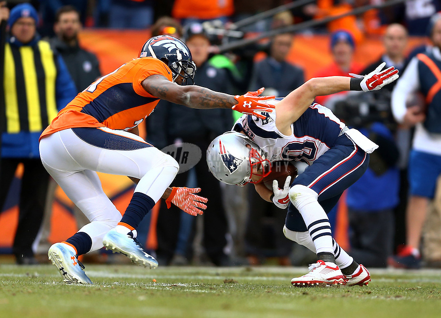 Jan 24, 2016; Denver, CO, USA; New England Patriots wide receiver Danny Amendola (80) tries to get past Denver Broncos cornerback Aqib Talib (21) in the second half in the AFC Championship football game at Sports Authority Field at Mile High. Mandatory Credit: Mark J. Rebilas-USA TODAY Sports