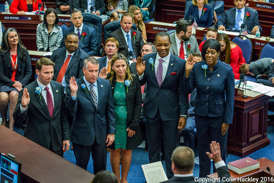 TALLAHASSEE, FLA. 11/22/16-Rep. David Silvers, D-West Palm Beach, left, Rep. Matt Willhite, D-Wellington, Rep. Emily Slosberg, D-Boca Raton, Rep. Al Jacquet, D-Lantana, and Rep. Patricia Hawkins-Williams, D-Lauderdale Lakes, take the oath of office from Judge Nicholas Thompson during the organizational session of the legislature at the Capitol in Tallahassee.<br /> <br /> COLIN HACKLEY PHOTO