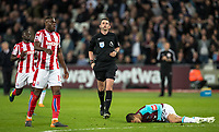 Referee Michael Oliver during the Premier League match between West Ham United and Stoke City at the Olympic Park, London, England on 16 April 2018. Photo by Andy Rowland.