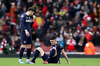 7th March 2020; Emirates Stadium, London, England; English Premier League Football, Arsenal versus West Ham United; A dejected Declan Rice and Aaron Cresswell of West Ham United after the 1-0 loss