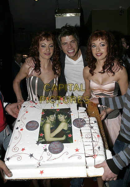 THE CHEEKY GIRLS & ANDY NEWTON-LEE.At their Birthday Party, Nell's/ Capise, Dover Street, London, November 17th 2004..half length cake drunk funny.Ref: AH.www.capitalpictures.com.sales@capitalpictures.com.©Capital Pictures.