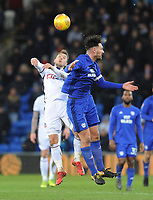 Bolton Wanderers' Adam Le Fondre vies for possession with Cardiff City's Sean Morrison<br /> <br /> Photographer Kevin Barnes/CameraSport<br /> <br /> The EFL Sky Bet Championship - Cardiff City v Bolton Wanderers - Tuesday 13th February 2018 - Cardiff City Stadium - Cardiff<br /> <br /> World Copyright &copy; 2018 CameraSport. All rights reserved. 43 Linden Ave. Countesthorpe. Leicester. England. LE8 5PG - Tel: +44 (0) 116 277 4147 - admin@camerasport.com - www.camerasport.com