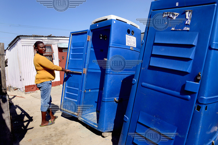 Thalita Booi (30) uses a toilet known as a Mshengu (chemical toilet). Before the Mshengus were installed in 2010, there were no toilets so she had to cross a main road and use a bush. She says: 'Crossing the road was a problem. There were tsotsis (criminals) who would grab you. At first I was excited. It was the first time I'd had a toilet in my life. But the Mshengus are bad. They are cleaned with very strong chemicals and if you sit on the toilet after they have been cleaned, you get a rash...We can't go at night, it is not safe. Sometimes the tsotsis lock you inside the toilet. Also, the Mshengus are not secured to the ground and sometimes children push them over.'
