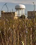 August 5, 2016. Flint, Michigan.<br />  The water tower at the Flint Water Plant. Since the water crisis, the city has reverted back to using water from Detroit and much of the water plant is off line. <br />  In April 2014, the city of Flint switched its water source from the Detroit Water and Sewerage Department to using the Flint River in an effort to save money. When the switch occurred, the city failed to have corrosion control treatment in place for the new water. This brought about a leaching of lead from pipes into the water, increasing the lead content in the drinking water to levels far above legal limits. After independent sources brought this to light, the city admitted the water was unsafe and legal battles have ensued between resident and the local and state governments.