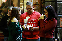 """Pictured: A Christmas reveller with a """"Pub is for life not just for Christmas t-shirt"""" in Wind Street, Swansea, Wales, UK. Friday 20 December 2019<br /> Re: Black Eye Friday (also known as Black Friday, Mad Friday, Frantic Friday) the last Friday before Christmas, in Swansea, Wales, UK."""