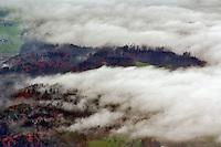 Fog moving across autumn landscape from atop Pilatus Mounain, Lucerne, Switzerland