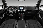 Stock photo of straight dashboard view of 2016 JEEP Wrangler-Unlimited Rubicon 5 Door SUV Dashboard