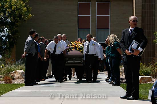 """Salina - Pallbearers carry the casket at the funeral for Gary """"Gibb"""" Jensen, held at the Salina LDS Stake Center. Jensen was killed with two others in the rescue and recovery operation at the Crandall Canyon Mine, where six men remain trapped.; 8.22.2007"""