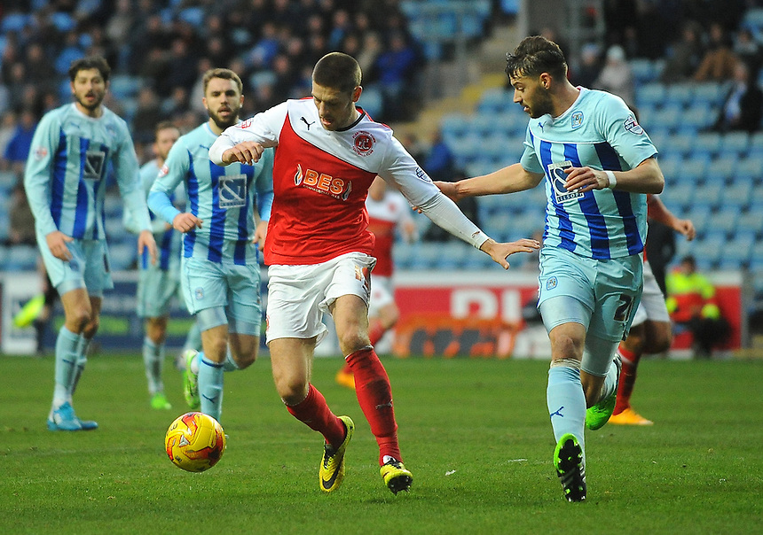 Fleetwood Town's Jamie Proctor under pressure from Coventry City's Aaron Martin<br /> <br /> Photographer Kevin Barnes/CameraSport<br /> <br /> Football - The Football League Sky Bet League One - Coventry City v Fleetwood Town - Saturday 20th December 2014 - The Ricoh Arena - Coventry<br /> <br /> &copy; CameraSport - 43 Linden Ave. Countesthorpe. Leicester. England. LE8 5PG - Tel: +44 (0) 116 277 4147 - admin@camerasport.com - www.camerasport.com