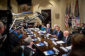 United States President Barack Obama and U.S. Vice President Joe Biden meet with members of the Presidential Commission on Election Administration in the Oval Office in Washington, District of Columbia, U.S., on Wednesday, Jan 22, 2014,  The Commission was created following the President's 2013 State of the Union pledge to identify non-partisan ways to shorten lines at polling places and provide better access to the polls for all voters. <br /> Credit: Pete Marovich / Pool via CNP