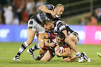Picture by David Neilson/SWpix.com/PhotosportNZ - 10/02/2018 - Rugby League - Betfred Super League - Wigan Warriors v Hull FC  - WIN Stadium, Wollongong, Australia - Wigan's Ben Flower is tackled by Hull FC's Dean Hadley and Marc Sneyd.