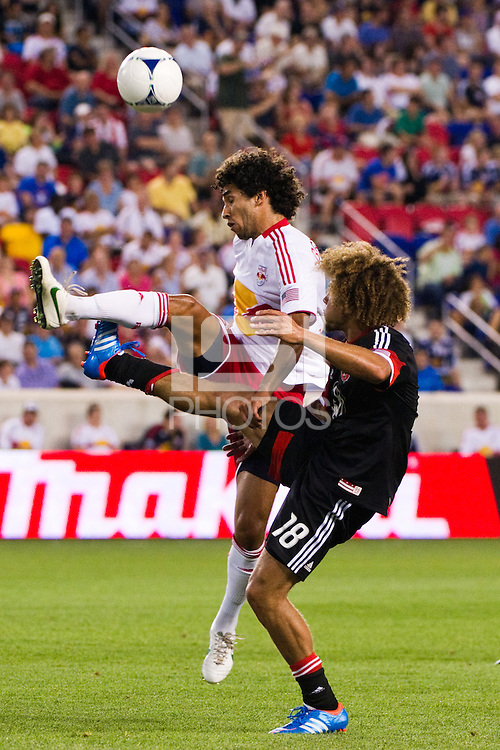 Mehdi Ballouchy (10) of the New York Red Bulls and Nick DeLeon (18) of DC United. The New York Red Bulls defeated DC United 3-2 during a Major League Soccer (MLS) match at Red Bull Arena in Harrison, NJ, on June 24, 2012.