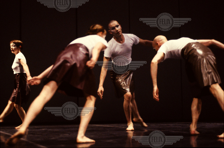 Ballet dancer Michael Clark is pictured with other performers during rehearsals for his show 'Mmm', a reinterpretation of Stravinsky's 'The Rite of Spring', at King's Cross Freight Depot.