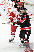 Taylor Holze (BU - 24), Dani Rylan (NU - 2) - The Boston University Terriers defeated the visiting Northeastern University Huskies 3-0 on Tuesday, December 7, 2010, at Walter Brown Arena in Boston, Massachusetts.