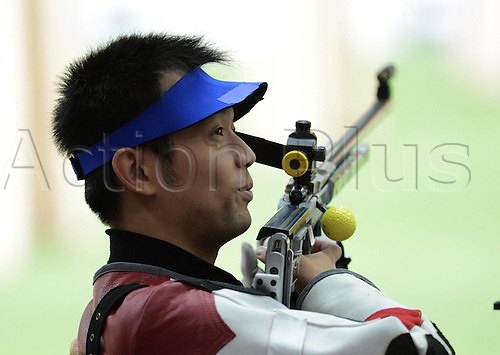 06.08.2012. London, England. Zhu Qinan of China competes in  The Qualification Match of mens 50m rifle 3   London 2012 Olympic Games