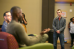 Matthew Cooper listens to Tarell Alvin McCraney, Friday, April 21, 2017 in the Lincoln Park Student Center. (Photo by Diane M. Smutny)
