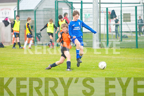 Alan McKeelan (Park) tries to do a sliding tackel to get thae ball from ( Michael Pott (Killarney Athletic) in the 1st round of the under14 National Cup, South Region Section at Christy Leahy Park, Mounthawk, Tralee on Saturday.