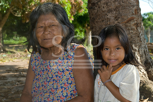 Pará State, Brazil. Iriri River. Aldeia Kararaô (Kayapó). Yokre Kayapó and grand daughter.
