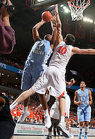 North Carolina forward Kennedy Meeks (3) shoots next to Virginia forward/center Mike Tobey (10) during an NCAA basketball game against Virginia Monday Jan. 20, 2014 in Charlottesville, VA. Virginia defeated North Carolina 76-61.