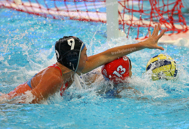 12th Fina World Swimming Championships, Womens Water polo 21st March, Netherlands v Greece, Gillian Van Den Berg desparately reaches for the ball.