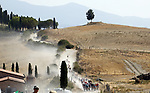 The peloton on the dusty Tuscan tracks at Lucignano d'Asso during the 2020 Strade Bianche Elite Men running 184km from Fortezza Medicea Siena to Piazza del Campo Siena, Italy. 1st August 2020.<br /> Picture: Bora-Hansgrohe/Luca Bettini/BettiniPhoto | Cyclefile<br /> <br /> All photos usage must carry mandatory copyright credit (© Cyclefile | Bora-Hansgrohe/Luca Bettini/BettiniPhoto)