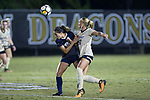 Monreau DeVos (27) of the Wake Forest Demon Deacons battles for the ball with Ashley Moreira (21) of the Pitt Panthers during second half action at Spry Soccer Stadium on September 15, 2017 in Winston-Salem, North Carolina.  The Demon Deacons defeated the Panthers 2-0.  (Brian Westerholt/Four Seam Images)
