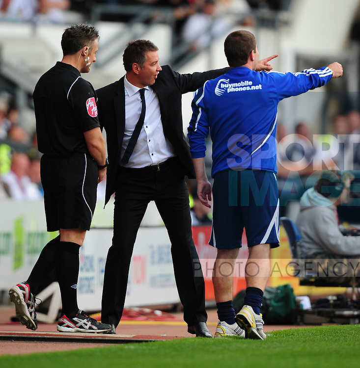 Nigel Clough manager of Derby County (L) and Darren Ferguson manager of Peterborough United (R) both complain to the fourth official during the game