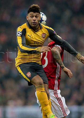 February 15th 2017, Munich, Germany;  Munich's Arturo Vidal (r) and Arsenal's Alex Oxlade-Chamberlain challenge for the ball during the first leg of the Champions League round of 16 tie between Bayern Munich and FC Arsenal in the Allianz Arena in Munich,