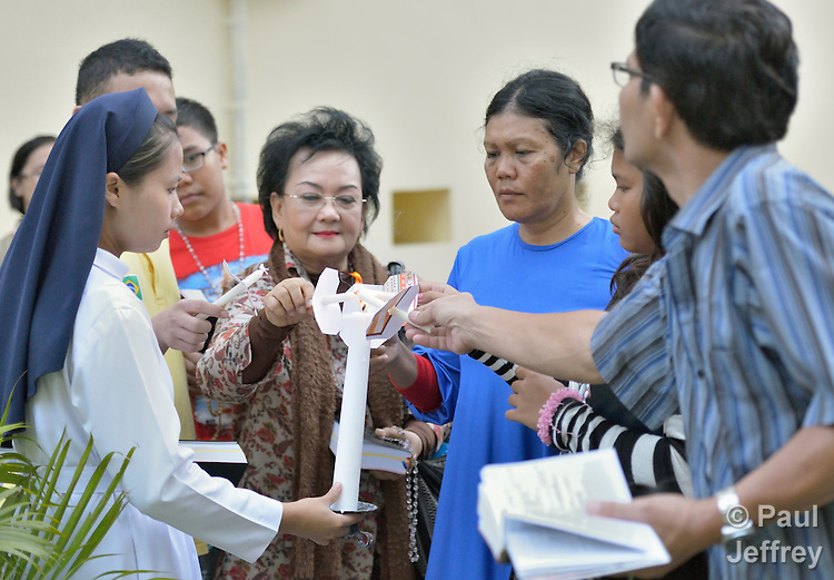 People light candles at the beginning of a rosary mass at the Sacred Heart Catholic Church in Banda Aceh, Indonesia.