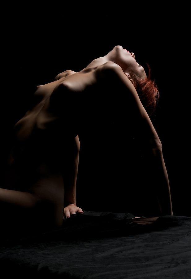 Young Caucasican woman posing in dim light.