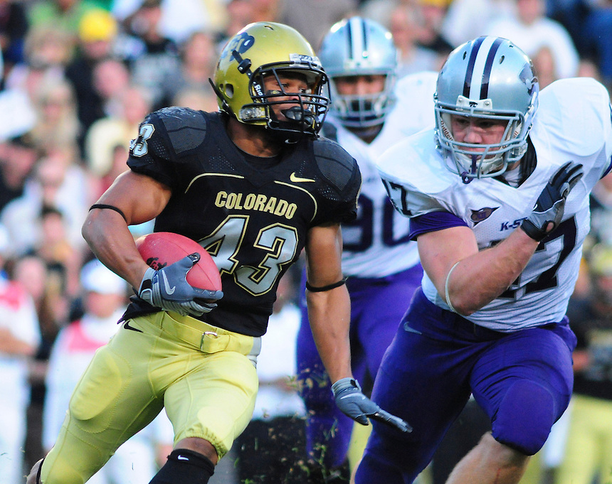 18 October 08: Colorado running back Rodney Stewart (43) rushes against Kansas State. Pursuing Stewart is Kansas State linebacker Alex Hrebec. The Colorado Buffaloes defeated the Kansas State Wildcats 14-13 at Folsom Field in Boulder, Colorado.