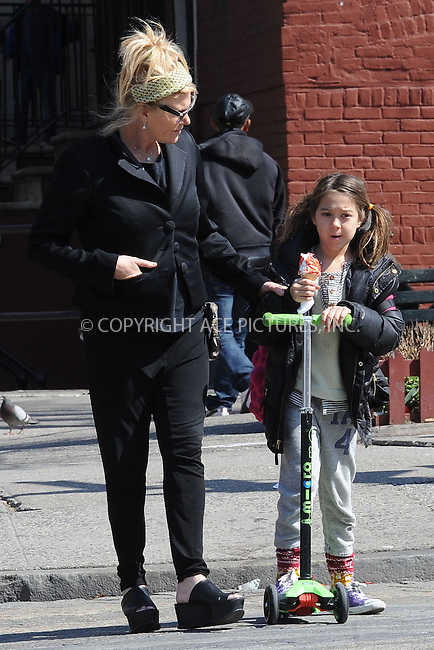 WWW.ACEPIXS.COM . . . . . .April 15, 2013...New York City....Deborra-Lee Furness and Ava Jackman take a walk in the West Village on April 15, 2013 in New York City ....Please byline: KRISTIN CALLAHAN - WWW.ACEPIXS.COM.. . . . . . ..Ace Pictures, Inc: ..tel: (212) 243 8787 or (646) 769 0430..e-mail: info@acepixs.com..web: http://www.acepixs.com .